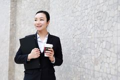 Business woman walking drinking coffee and Notebook computer. Business woman walking drinking coffee. Lawyer professional or similar walking outdoors happy royalty free stock photo