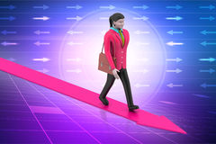 Business woman walking on growing arrow Royalty Free Stock Images