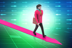Business woman walking on growing arrow Stock Images