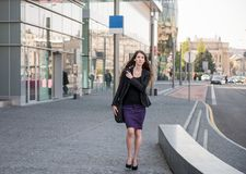 Business woman walking in hurry Royalty Free Stock Photography