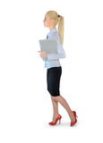 Business woman walking with laptop Royalty Free Stock Photos