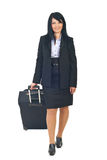 Business woman walking with luggage. Business woman or stewardess  going in a travel and carry a luggage isolated on white background Royalty Free Stock Image