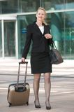 Business woman walking outdoors with luggage Royalty Free Stock Photos
