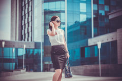 Business woman walking outside in city Royalty Free Stock Photo