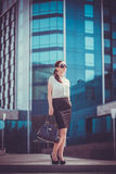 Business woman walking outside in city Stock Photography