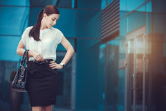 Business woman walking outside in city Stock Image