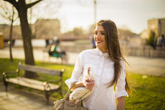 Business woman walking in a park Royalty Free Stock Images