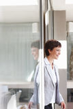 Business woman walking past a glass door Royalty Free Stock Photo