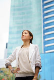 Business woman walking proud city office building Royalty Free Stock Image
