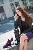 Business woman walking on stairs calling phone Royalty Free Stock Photography