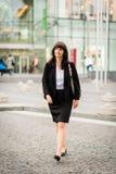 Business woman walking street Stock Photos