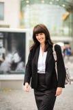 Business woman walking street Stock Image