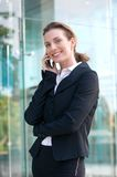 Business woman walking and talking on mobile phone Stock Photo
