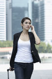 Business woman walking and using a Cell Phone Stock Image