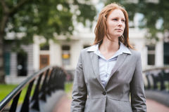 Business Woman Walks on a Bridge in a City Stock Photography