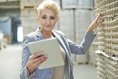 Business woman in warehouse Stock Photos