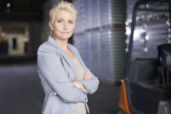 Business woman in warehouse Stock Image