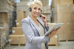 Business woman in warehouse Royalty Free Stock Images