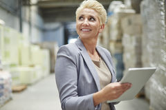 Business woman in warehouse Stock Photo