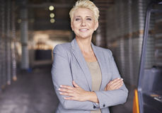 Business woman in warehouse Stock Images
