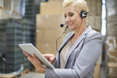 Business woman in warehouse Royalty Free Stock Image