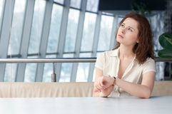 Business woman with watch at office Stock Images