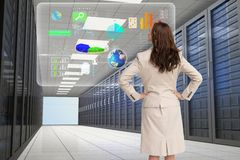 Business woman watching at a graph on the server room Royalty Free Stock Image