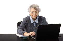 Business woman watching suspicious news on the internet Royalty Free Stock Photos