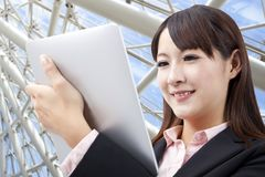 Business woman watching touch pad Royalty Free Stock Images