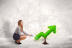 Business woman watering green plant arrow Stock Image