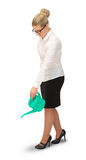 Business woman watering something Royalty Free Stock Photography