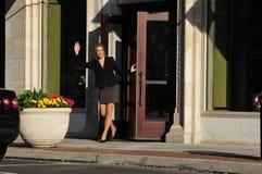 Business woman waving hello Royalty Free Stock Image