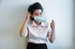 Business woman wear hygiene mask and sick. Business woman starts to wear hygiene mask to prevent flu and sickness Stock Photography
