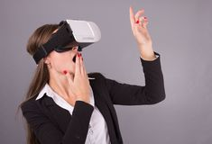 Business Woman in wearable technology VR glasses. Confident youn Royalty Free Stock Images
