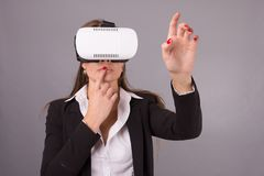 Business Woman in wearable technology VR glasses. Confident young woman in a business suit in virtual reality headset Stock Images