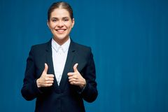 Business woman wearing black suit shows thumb up. Stock Image