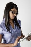 Business woman wearing glasses on her tablet Royalty Free Stock Images