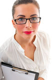 Business woman wearing glasses holding clipboard. Portrait of beautiful business woman in a white shirt and grey skirt with clipboard over white background Royalty Free Stock Photography