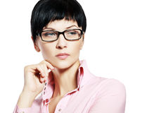 Business woman. Wearing glasses looking suspicious outside the picture, short haircut Stock Photo
