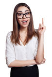Business woman wearing glasses pointing up isolated on white Royalty Free Stock Images