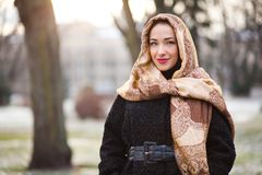 Business woman wearing headscarf. Smiling young and happy business woman wearing scarf Royalty Free Stock Photography