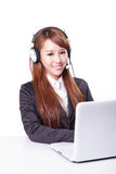Business woman wearing headset with smile Stock Image