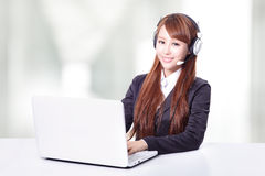 Business woman wearing headset with smile Royalty Free Stock Photography