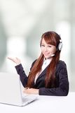 Business woman wearing headset with smile Stock Photography