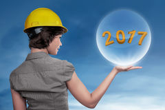 Business woman wearing helmet showing 2017 in the sphere Royalty Free Stock Images