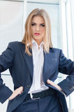 Business woman wearing man's suit in office Royalty Free Stock Photo