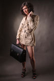 Business woman wearing a raincoat Stock Image