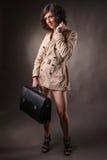 Business woman wearing a raincoat Stock Image