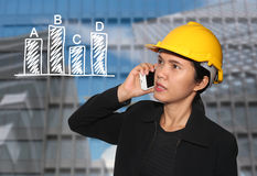 Business Woman wearing a safety hat in call phone and have Skysc Royalty Free Stock Photos