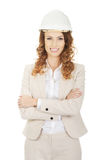 Business woman wearing white helmet. Royalty Free Stock Images
